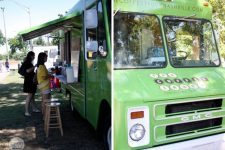 A green food truck in Nashville, TN.