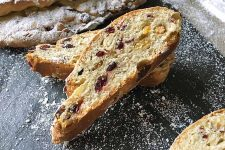 Horizontal image of two slices of stollen.