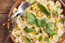 A bowl filled with the summer flavors of a fresh corn pasta salad. | Foodal.com