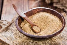 Close up of a wooden salad bowl filled with amaranth seed | Foodal