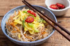 A finished fried bee hoon with chicken, veggies, and eggs. | Foodal.com