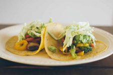 Garlic Ginger Vegetarian Tacos With Sweet and Spicy Cabbage Slaw on a white, porcelain plate.