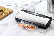 The Gourmia GVS435 Stainless Steel Vacuum Sealer on a marble kitchen counter.