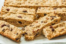 Close up of sliced homemade vegan oatmeal breakfast bars on butcher paper.