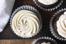Horizontal image of cupcakes with white piped frosting.