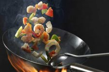 How to Use A Wok For Stir Frying & Steaming | Foodal.com