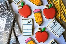 Horizontal top-down image of assorted back to school decorated desserts.