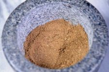 A mortar full of fully ground homemade poultry seasoning | Foodal