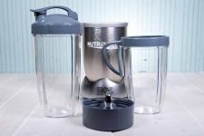 The base and two go-cups as part of the NutriBullet Pro 900 Personal Blender.