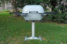 A Silver PK Grill 360 in a backyard setting.