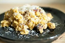 Pumpkin Kamut with Pecorino and Hazelnuts. Close up.