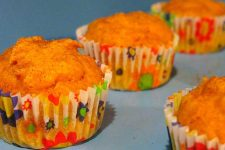 Four pumpkin muffins in cupcake wrappers | Foodal