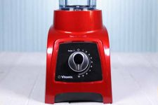A closeup of a red Vitamix S30 Personal Blender lower base.