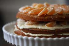 A close up image of a Satsuma layer cake, looking so delicious.