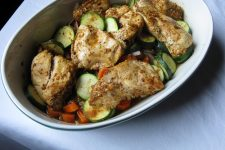 Top view of a white porcelain oval bowl full of Savory Low-Calorie Spiced Chicken | Foodal