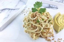 Plated spicy kohlrabi slaw with a fun cilantro and peanut garnish. | Foodal.com