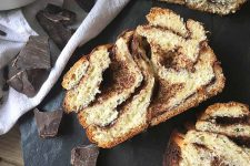 Horizontal image of a slice of baked pastry with chocolate swirls.