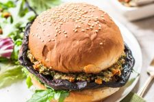 Oblique view of a vegan portabella mushroom burger on a bun.