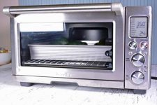 Oblique view of a convection toaster oven being used to prepare roasted stuffed acorn squash