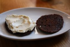 Thin chocolate cookies topped with vanilla ice cream.