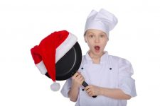 Girl chef surprised with new Christmas gift isolated on white