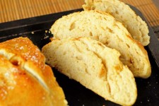 The best roasted garlic bread baked and complete on a cookie sheet - sliced with interior exposed