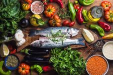 Colorful display of raw food items like fish and assorted vegetables | Foodal.com